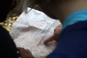 Look at a map to find the best route to your new home.