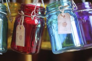 Mason jars of different colors.