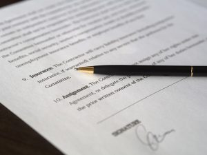 A contract and a pen on top of it.