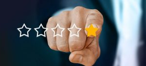 a finger pointing at one yellow star
