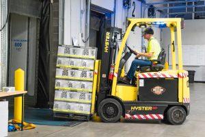 A worker inside a warehouse