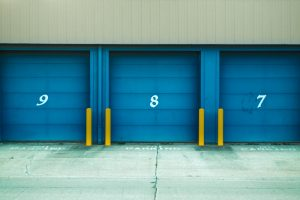 storage units with blue doors and numbers 9, 8, and 7 on them