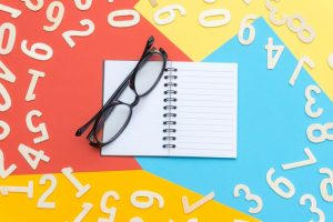 bunch of colors, colorful background, a notepad and glasses