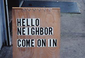 """A """"hello neighbor"""" sign"""