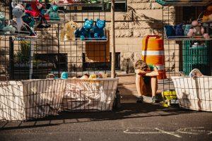 a boy selling items - a yard sale