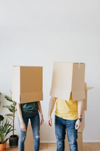 Picture of a couple with cardboard boxes on their heads