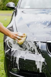 Picture of a woman cleaning a car. Visit your local carwash before shipping your car to Hong Kong