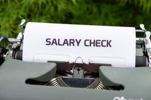 """salary check"" on typing machine"