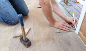 person repairing the floors