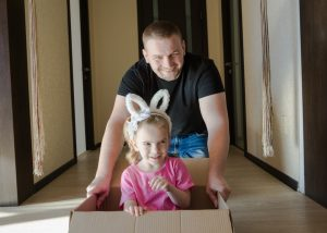 A father and daughter moving