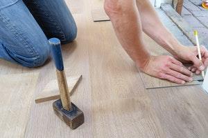 Person measuring wooden floor