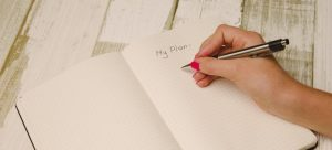 A pen in hand and a planner