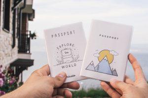 people holding passports