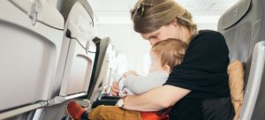 A mother and a baby on an airplane