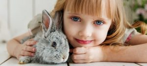 A girl with a bunny pet