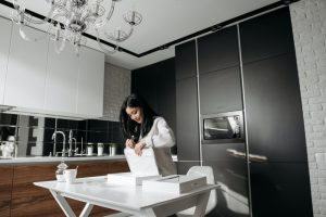 a girl in the kitchen with boxes