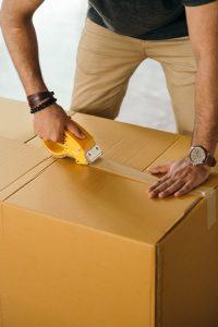 a man sealing a box