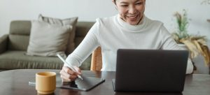 a woman writing on her ipad